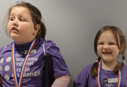 Two young girls at the Oklahoma Regional Braille Challenge