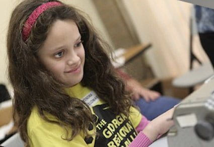 Girl at the Georgia Regional Braille Challenge