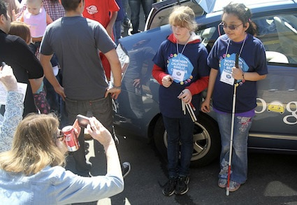 Two young girls pose for a picture at the Northern California Regional Braille Challenge