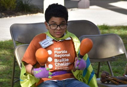 Young boy partipating in the 2020 Florida Regional Braille Challenge