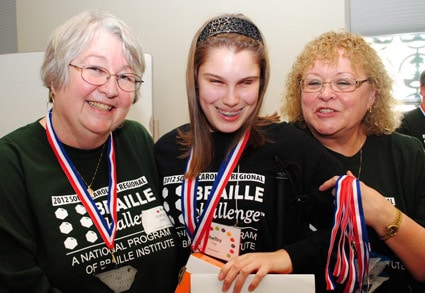Student being recognized at South Carolina Braille Challenge Regionals