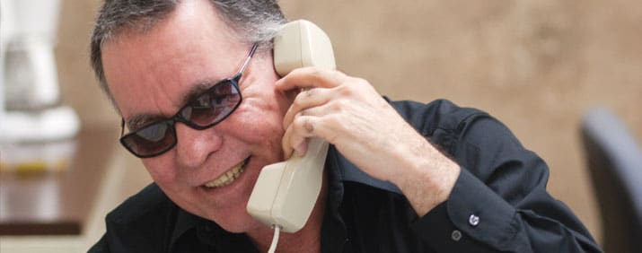 Man in glasses talking on the phone