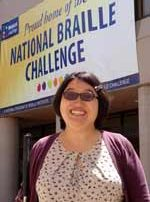 Tiffany Kim in front of Braille Challenge banner