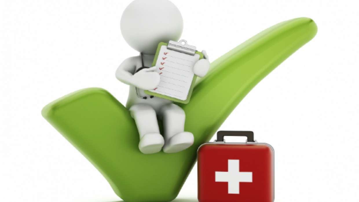 Graphic of a stick figure with clipboard and stethoscope sitting on a green checkmark, next to a red suitcase with medical white cross