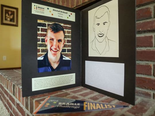 A poster board displays a biography and picture of Mitchell Bridwell that was displayed at the Braille Challenge recently, seen at his family's home in Pittsboro, Ind., Thursday, July 12, 2018. The 17-year-old recently won the Braille Challenge varsity championship for the second consecutive year at the University of Southern California. Bridwell will be a senior at the Indiana School for the Blind and Visually Impaired this fall. (Photo: Jenna Watson/IndyStar)