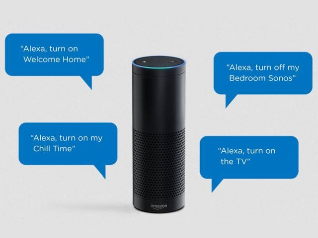 "An Alexa speaker with graphics of speech bubbles with words such as ""Alexa, turn on the TV"""