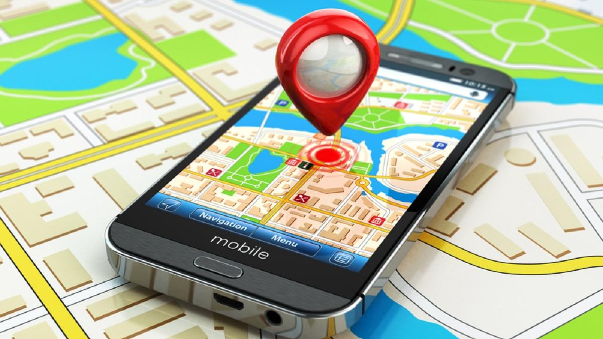 Graphic with a location icon hovering over a smartphone with a map app