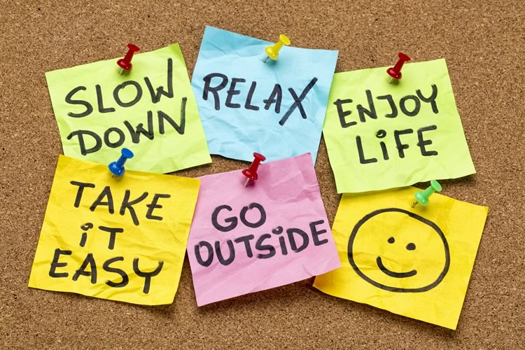 "6 color post-it notes with the words, ""Slow Down"", ""Relax"", ""Enjoy Life"", ""Take It Easy"", ""Go Outside"", and a happy face"