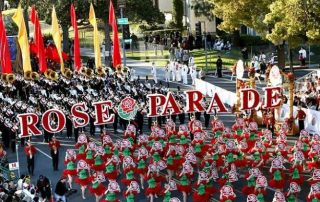 Participants in Rose Parade holiday letters that spell Rose Parade