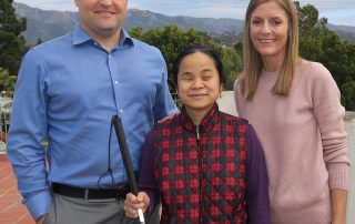Ben Pomeroy, Nutsiri Kidkul, and Susan Cass stand together and smile