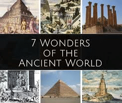 """Postcard image with the text """"7 Wonders of the Ancient World"""" and images of 6 of the wonders, including the Great Pyramid"""