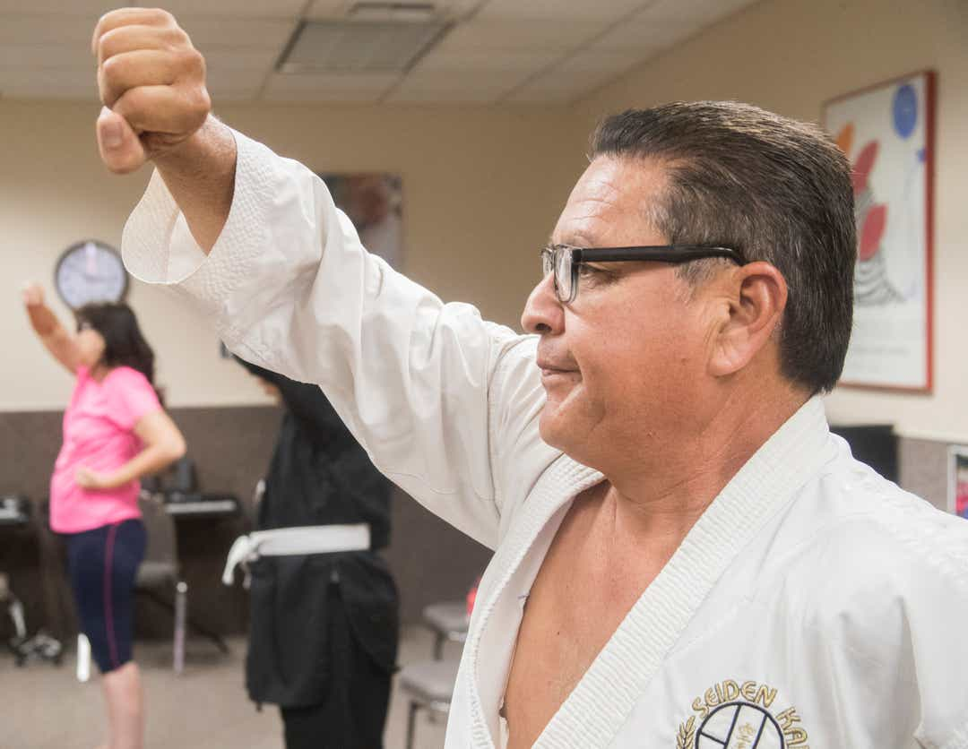 Antonio D. practices Karate during a class at the Braille Institute in Rancho Mirage. Antonio Delgado won 3rd place recently during an international competition.