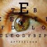 Eye Chart overlaid on one brown eye