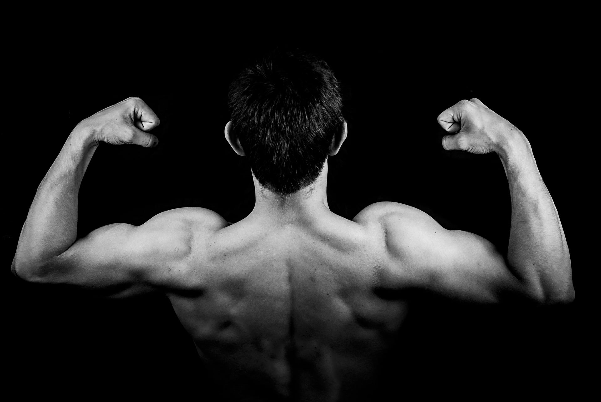 Man flexing arms and back