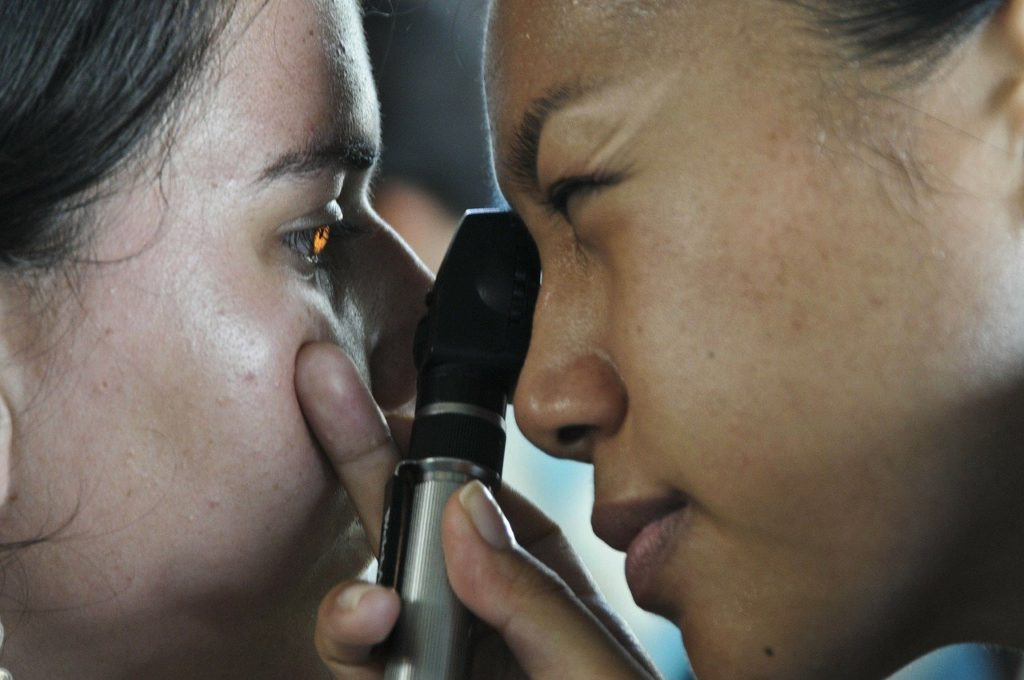 Doctor examining patients eye