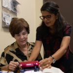 Photo of low vision magnifier demonstration.