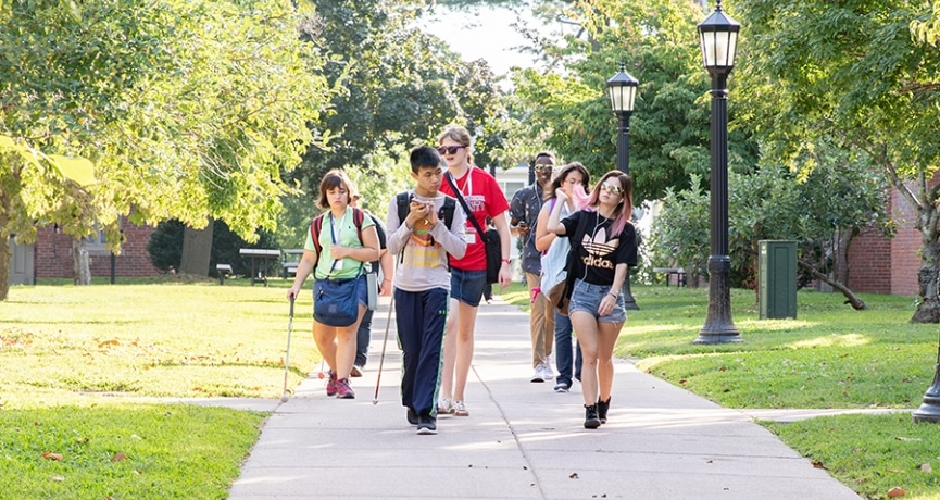 a group of blind students walking on campus