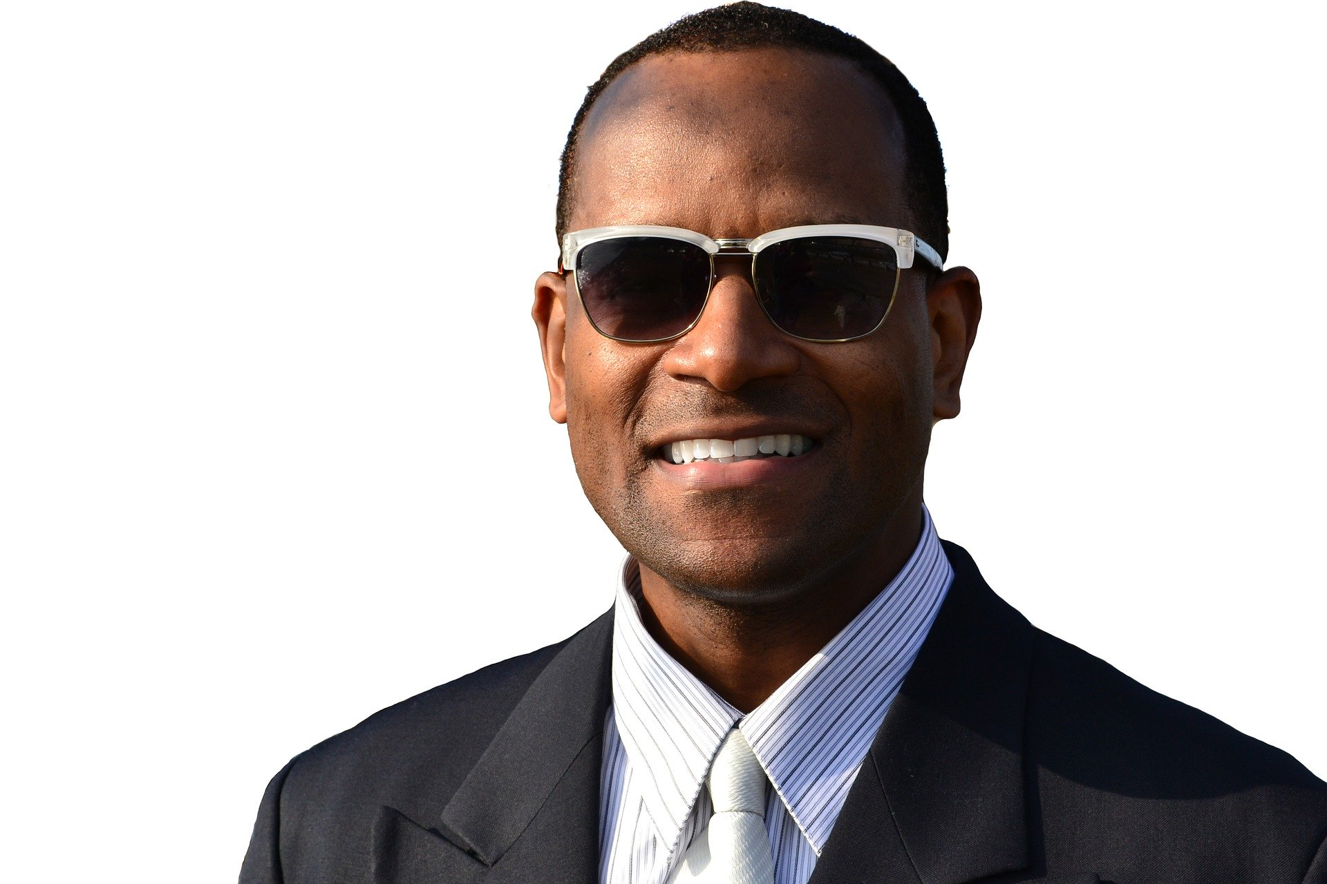 African American man wearing business suit and tie, fashionable sunglasses