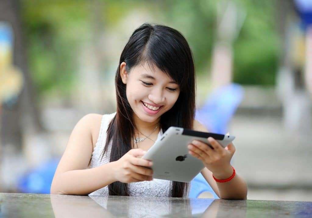 Young adult, Asian girl looking at ipad