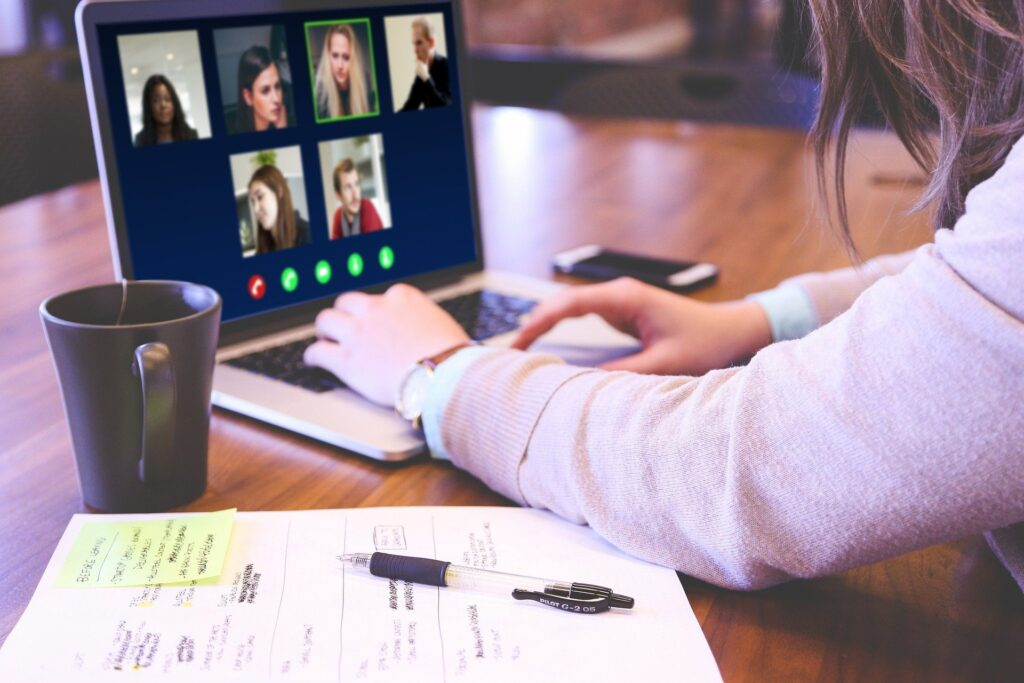 Young adult on video conference from laptop