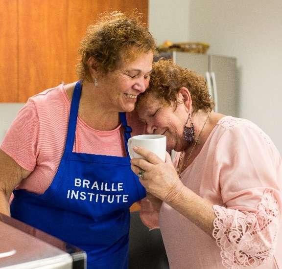 Two women in class in a Braille Institute kitchen
