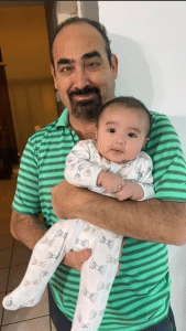 Braille Institute student Leo with baby.